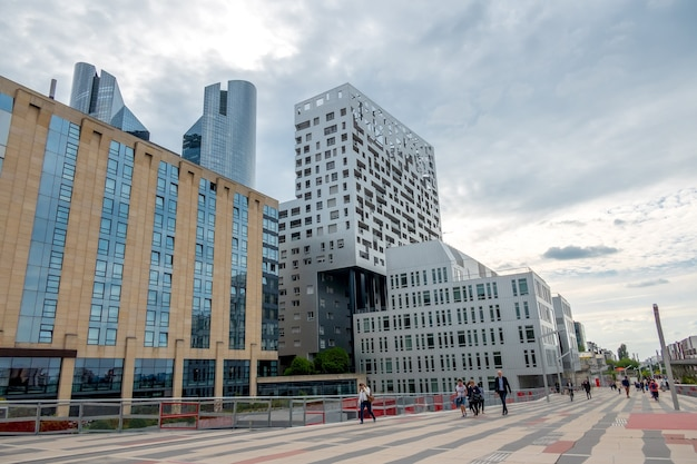 France. cloudy summer day in the parisian district of la defense. modern buildings and pedestrian street