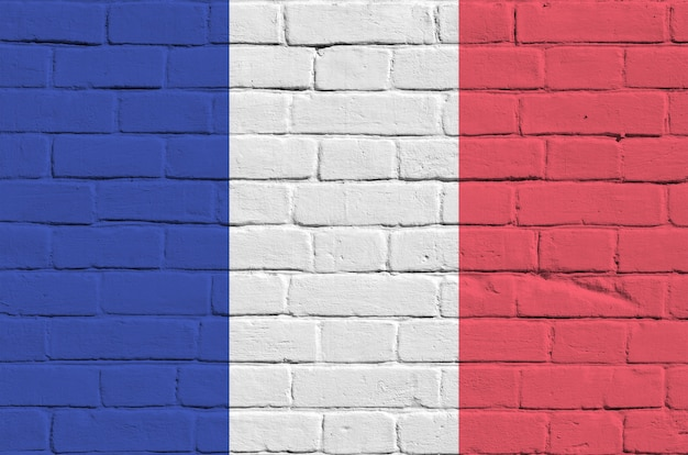 France flag depicted in paint colors on old brick wall. textured banner on big brick wall masonry background