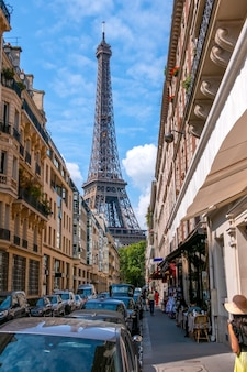 France. narrow street of paris in summer sunny weather. the eiffel tower