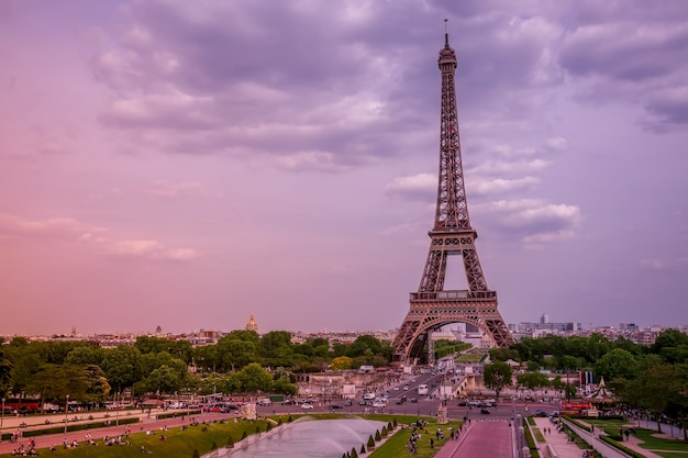 France. paris. eiffel tower and fountains of the trocadero gardens. pink summer evening