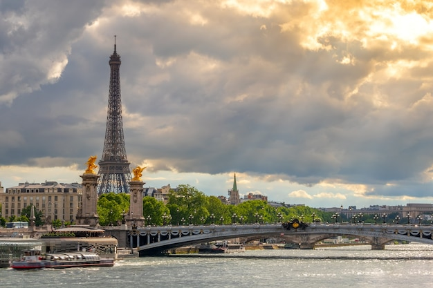 France. paris. heavy clouds and the rays of the sun. traffic on the seine