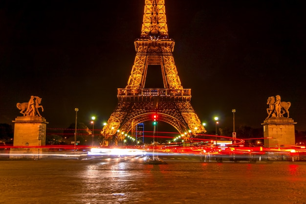 France, paris. night at the foot of the eiffel tower. traffic on the jena bridge