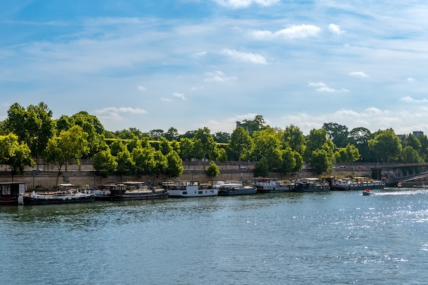 France. paris. summer day. river seine. many houses on the water moored at granite embankments