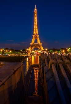 France. summer night in paris. the famous eiffel tower and reflection. editorial use only