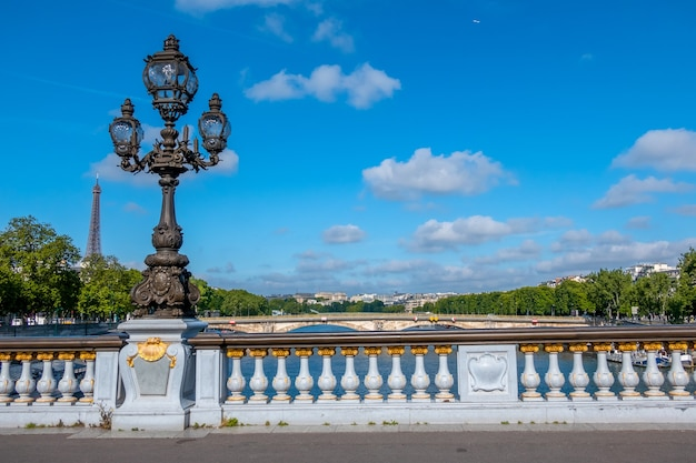 France. sunny summerday in paris. lantern on the bridge alexandre iii across the river seine