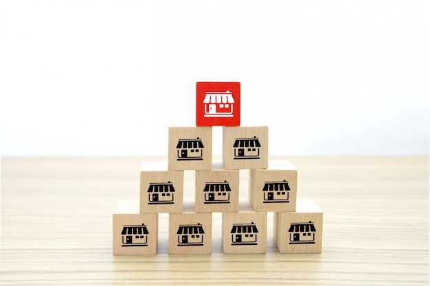 Franchise business icons on wooden cube shape.