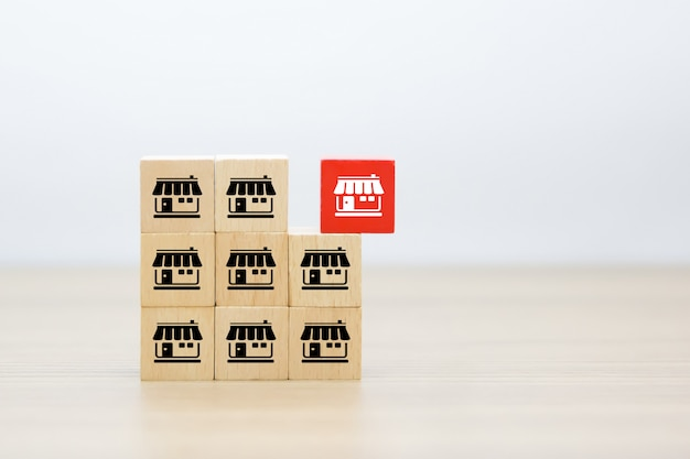 Franchise icons on wooden cube shape stacked.