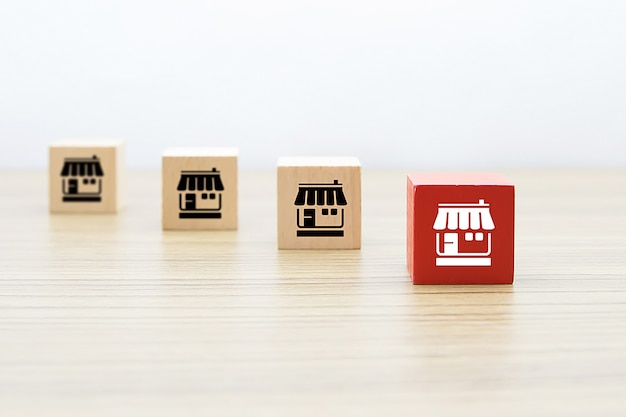 Franchise marketing icons store on wooden blocks.