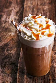 Frappe coffee on wooden table