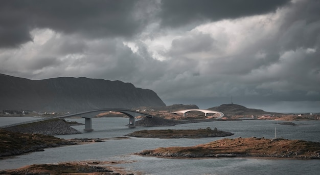 Fredvang bridge and the surrounding mountains and sea on the lofoten islands norway in autumn under gloomy clouds
