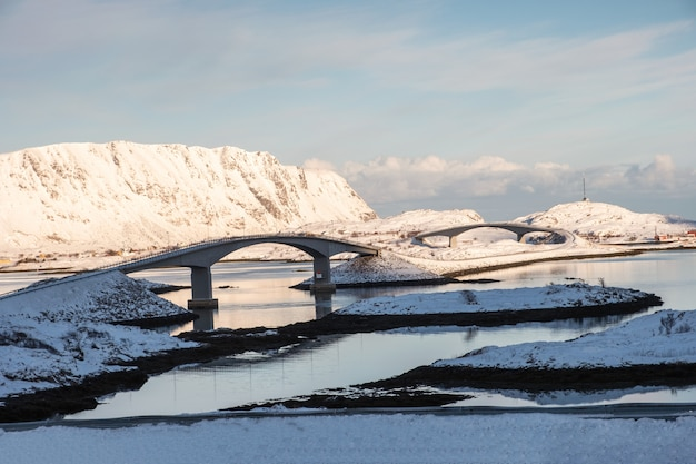 Fredvang bridges cross islands with mountain in winter at coastline