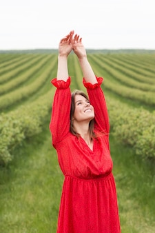 Free woman in green field