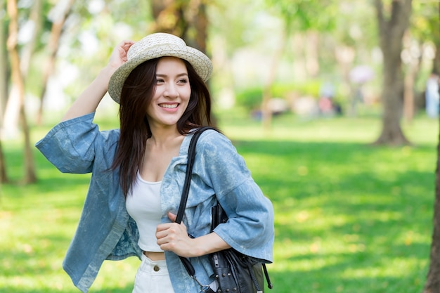 Freedom and finding concept: casual cute smart asian women walking in the park in summer