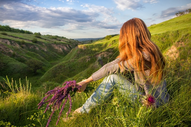 Freedom - girl on the nature in sunset time