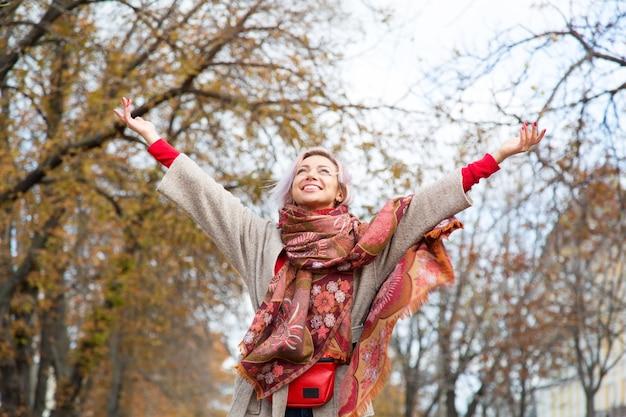 Freedom, happy woman enjoying autumn nature.
