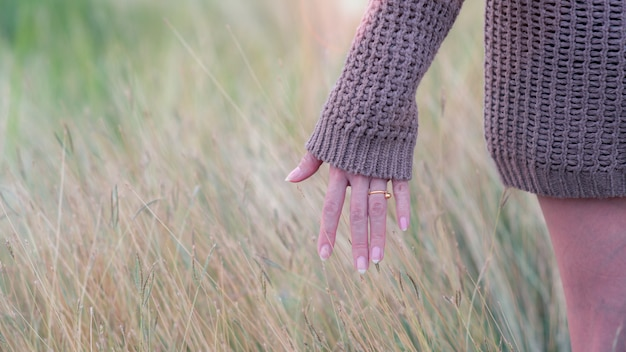Freedom woman hand feels to the meadows.