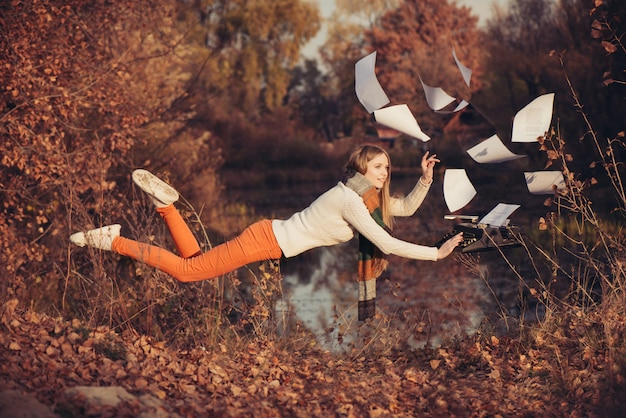 Freedom in the work. woman levitation in the nature