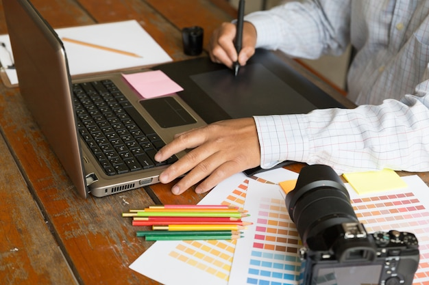 Freelance graphic designer using digital tablet