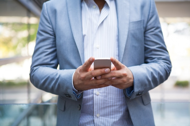 Freelance manager texting message on smartphone