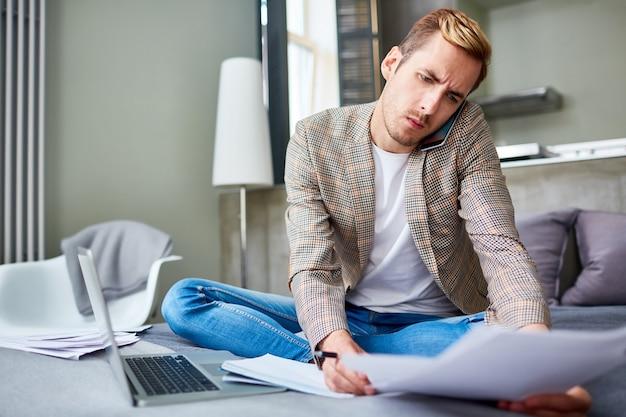 Freelance worker using smartphone