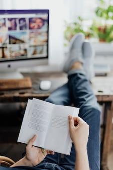 Freelancer casually reading a book