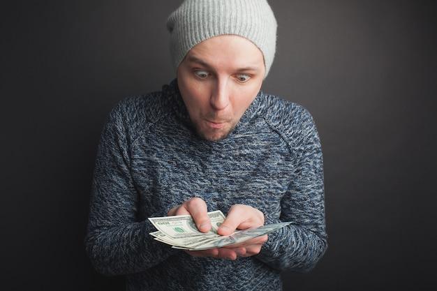 Freelancer holds money.