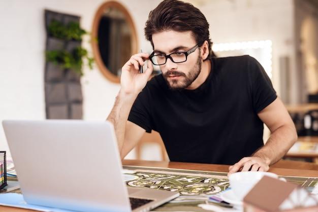 Freelancer sitting at desk works at project.