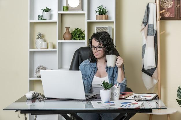 Freelancer using laptop at home