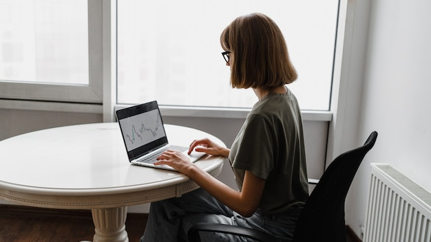 Freelancer woman using laptop computer sitting at home. freelance work, business people concept
