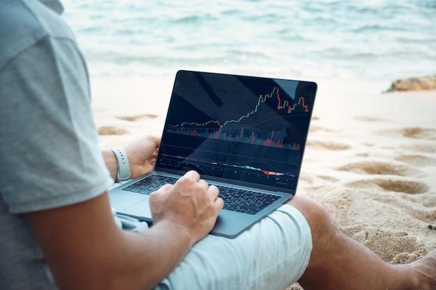 Freelancer work by laptop on tropical beach