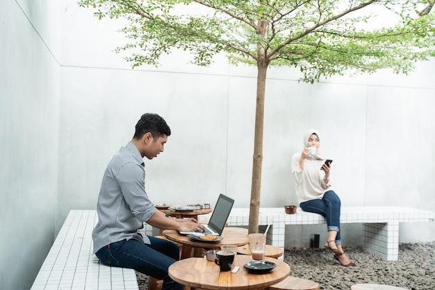 Freelancer work using laptop in cafe