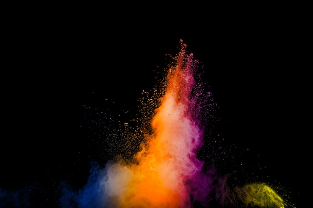 Freeze motion of color dust  particles splash. painted holi in festival.