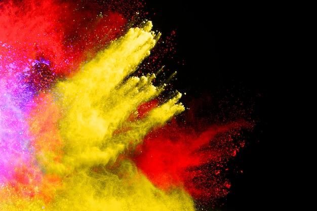 Freeze motion of color powder exploding/throwing color powder, multicolored glitter texture.