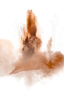 Заморозить движение взрыва коричневой пыли. остановка движения коричневого порошка