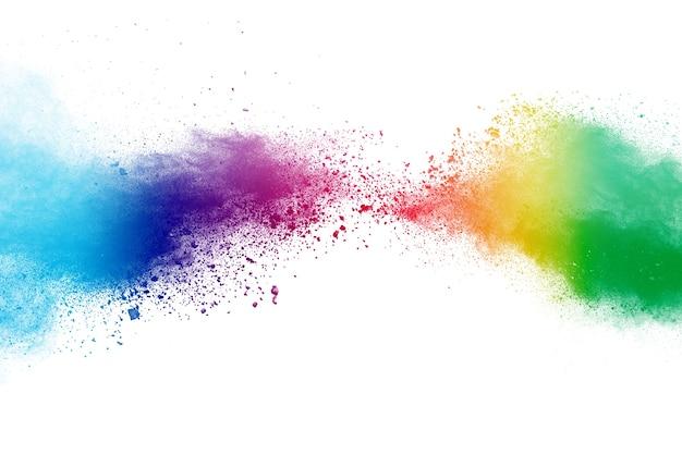 Заморозьте движение цветного порошка, взрывающегося на белом фоне.