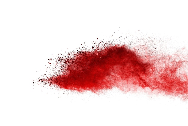 Freeze motion of red color powder exploding on white