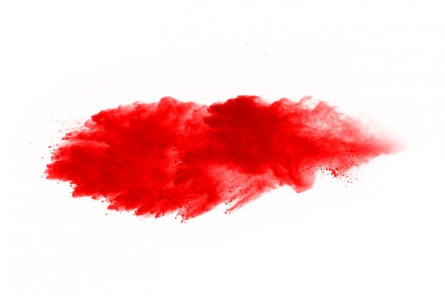 Freeze motion of red powder exploding, isolated on white. abstract design of red dust cloud.