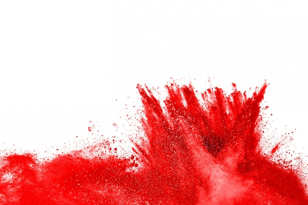 Freeze motion of red powder exploding, isolated on white background
