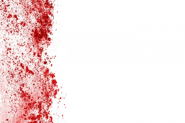 Freeze motion of red powder exploding, isolated on white background.