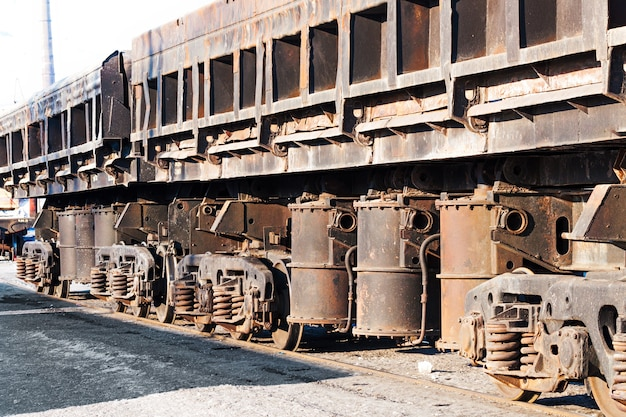 Freight cars at the railway station. wheels and wheel truck with three axles