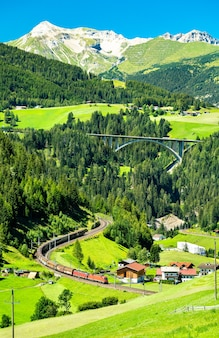 Freight train at the brenner railway in the austrian alps