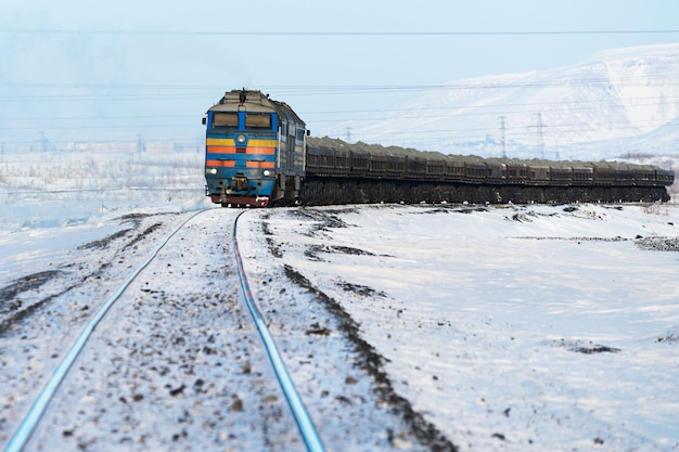 Freight train moving on the tracks in the winter