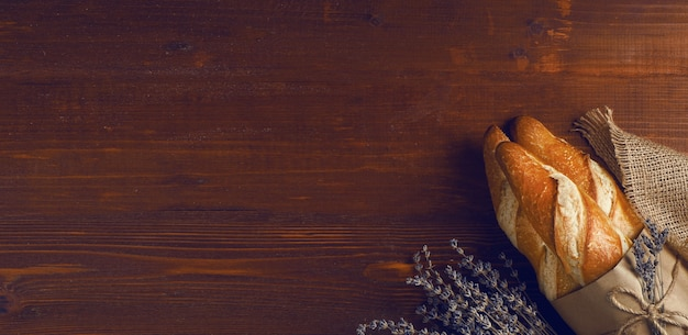 French baguette in a rustic style on a wooden table