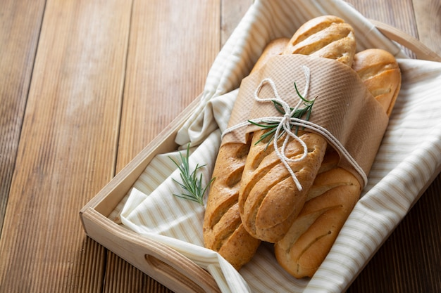 French baguettes on wooden table