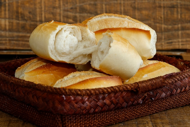 French bread basket on rustic wooden background