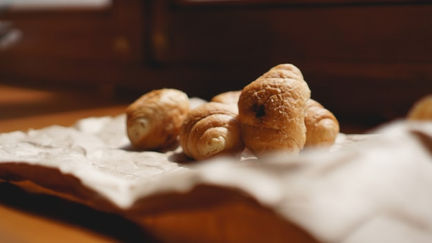 French breakfast with croissant, kraft crockery on kraft paper. mini croissants