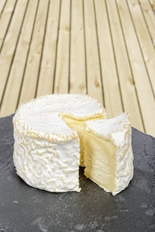 French cheese placed on a black slate