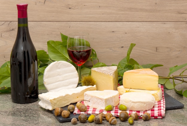 French cheese with a glass and a bottle of wine
