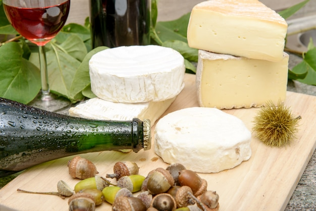 French cheeses with a bottle of cider