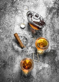 French cognac with a cigar.